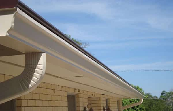 A downspout attached to a seamless gutter system